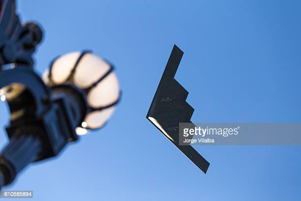 b-2 stealth bomber flying over pasadena ca at rose parade - stealth bomber stock photos and pictures