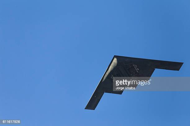 b-2 stealth bomber flying over pasadena ca at rose parade - explosives stock photos and pictures