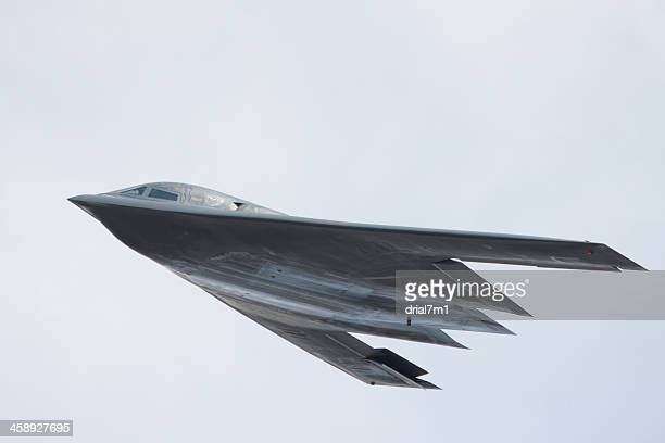 b-2 stealth bomber in flight - stealth bomber stock photos and pictures