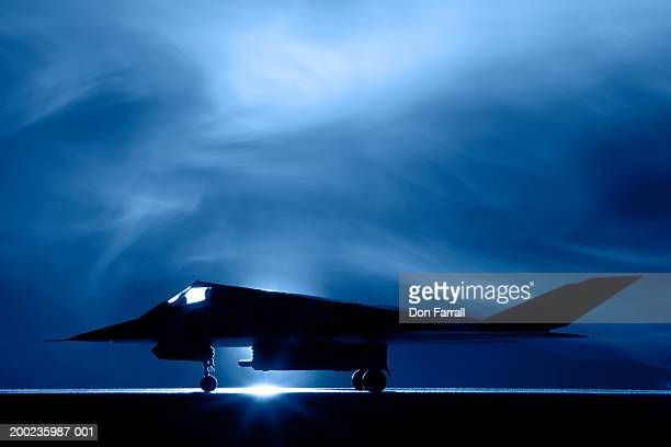 stealth f-117 bomber, side view - stealth bomber stock photos and pictures