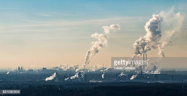Steam and exhaust rise from the chemical company Oxea and the coking plant KBS Kokereibetriebsgesellschaft Schwelgern GmbH on a cold winter day on...