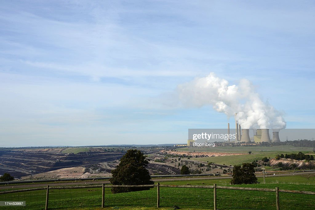 Steam billows from the cooling towers at the Loy Yang A coal-fired power station, operated by AGL Energy Ltd., front, and Loy Yang B coal-fired power station, co-owned by GDF Suez Australian Energy and Mitsui & Co., rear, as they stand next to the Loy Yang open cut coal mine on the outskirts of Traralgon, Australia, on Thursday, July 25, 2013. Australian Prime Minister Kevin Rudd will cut spending and limit tax concessions to fund a move to emissions trading a year ahead of schedule, should his Labor government win this year's election. Photographer: Carla Gottgens/Bloomberg via Getty Images
