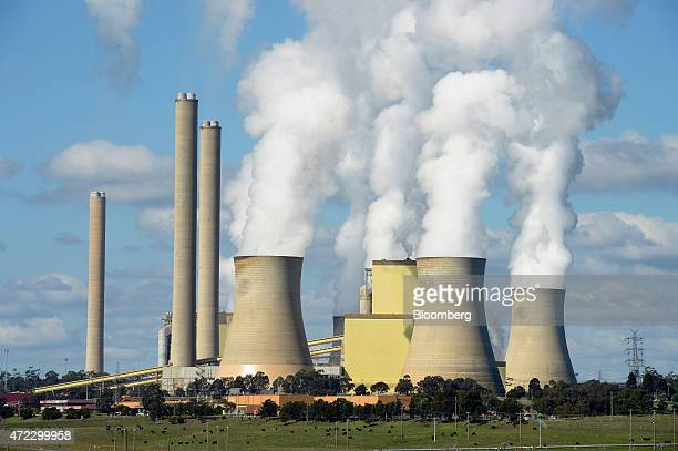 Steam billows from the cooling towers of the Loy Yang coalfired power station operated by AGL Energy Ltd in the Latrobe Valley Australia on Wednesday...