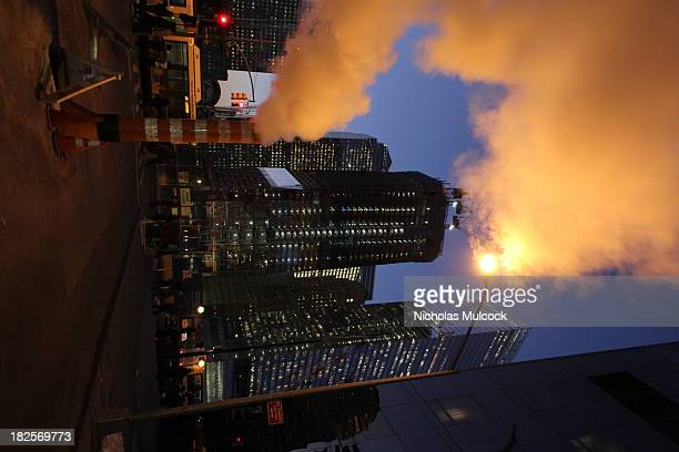 Steam billows out of the construction of the new tower and others around the new World Trade Center in downtown Manhattan, NYC. The construction crew...