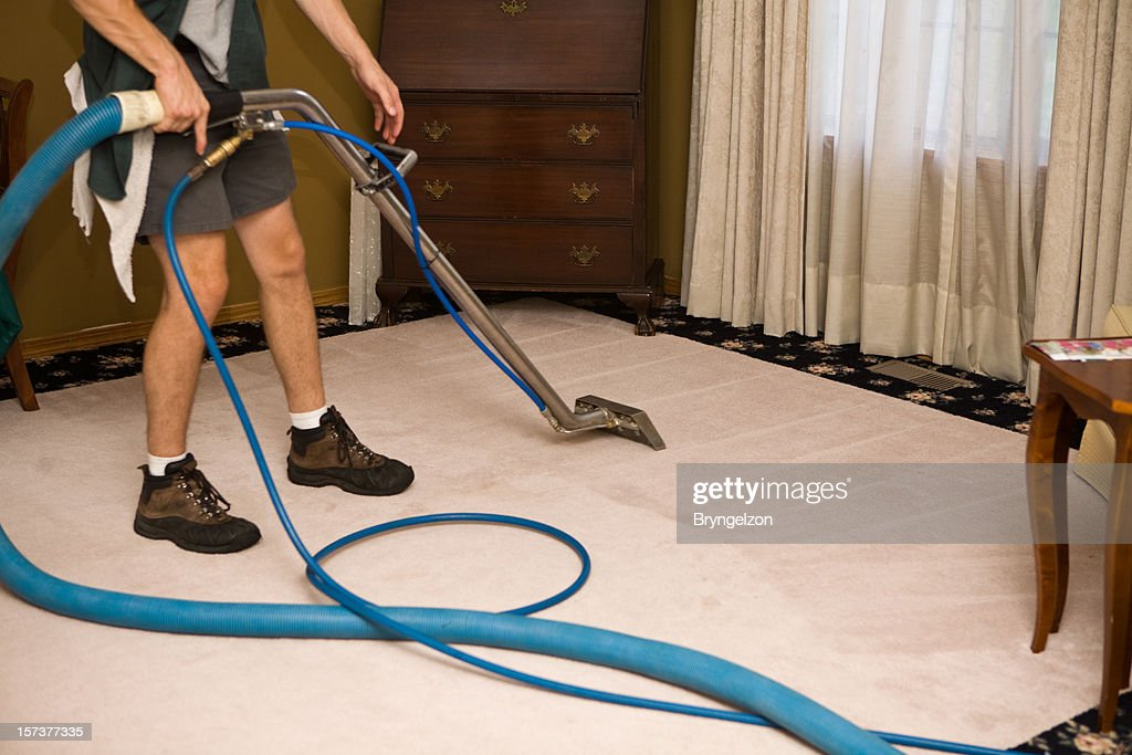 Steam Cleaning the Living Room : Stock Photo