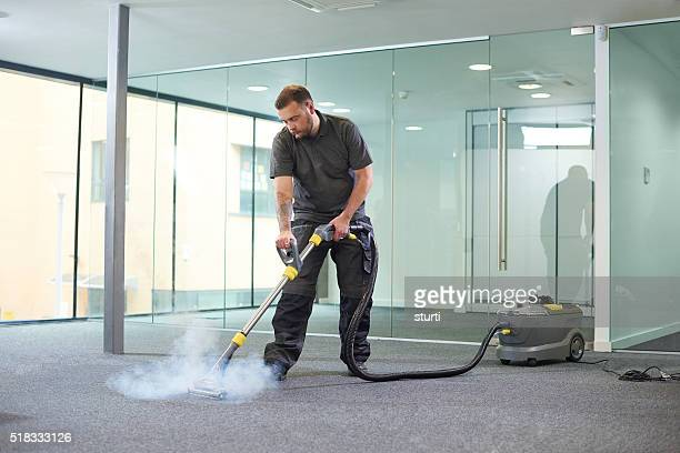 steam cleaning the office carpet - tapijt stockfoto's en -beelden