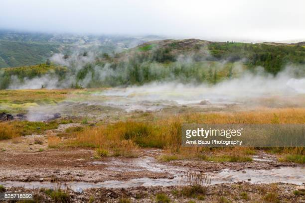 Steam coming out of groud at Geysir, Iceland