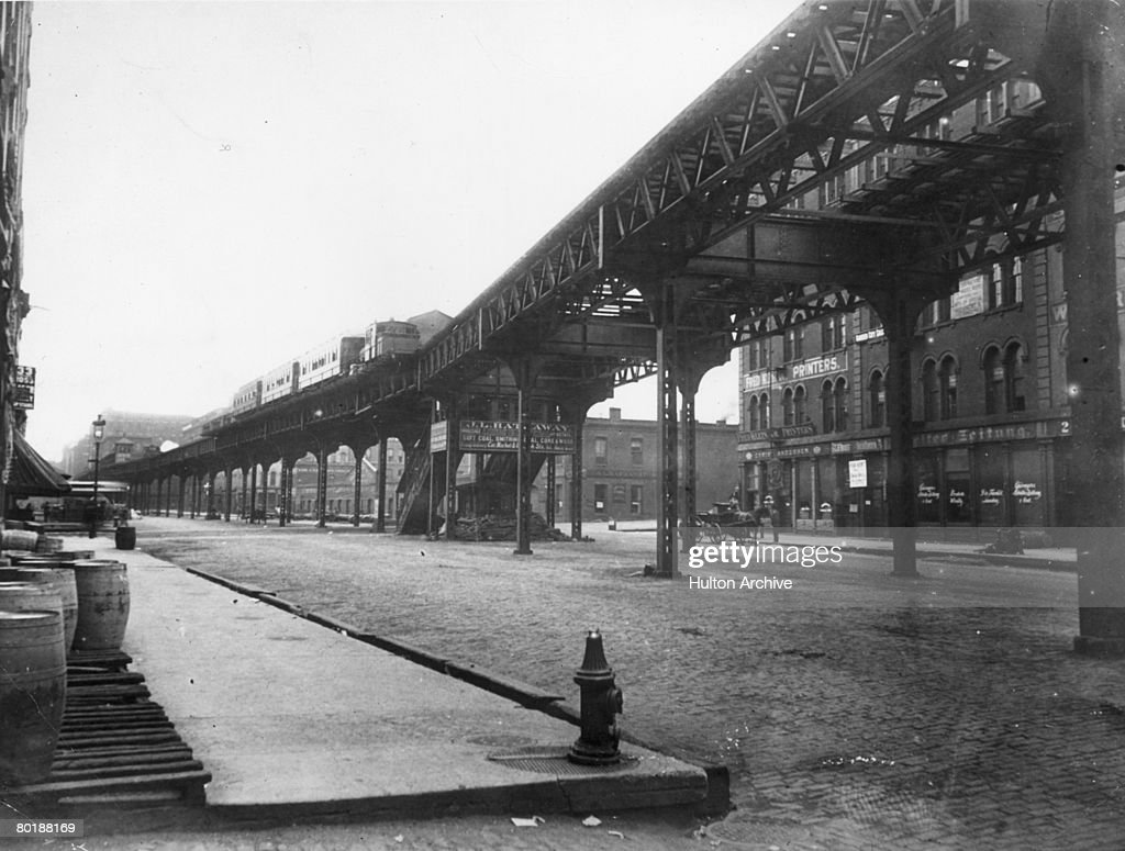 A steam elevated railway on Market Street near Lake Street in Chicago, 30th June 1895.