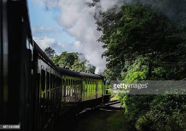 Steam engine and carriages from the Lakeside and Haverthwaite Railway makes its way along the 3.2 mile long heritage line leading from Lake...