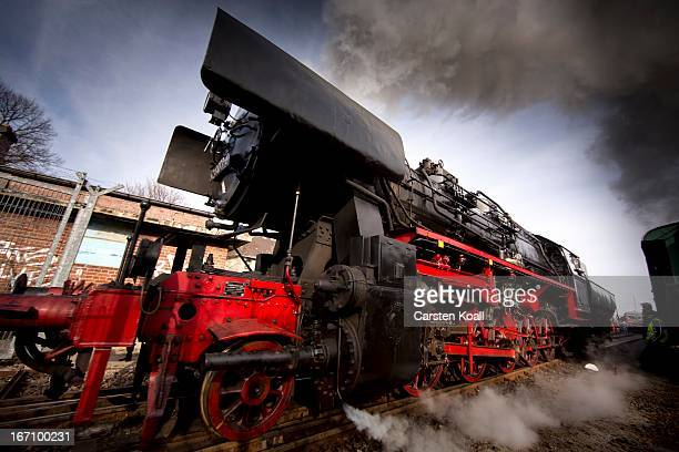 A steam engine locomotive of Type 52 produced in Germany during World War II rides visitors during open house day at the depot of historic trains of...