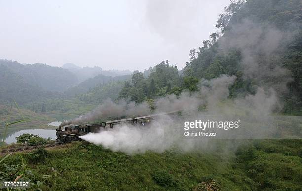 A steam engine of Jiayang Trainset runs on October 4 2007 in Qianwei County of Leshen City Sichuan Province China The narrowgauge railway was built...