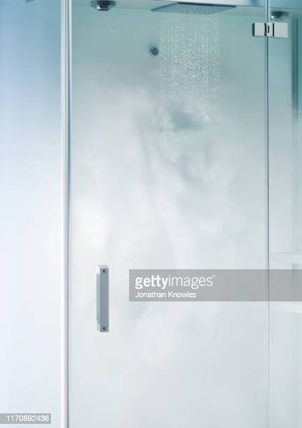 steam female in shower - sliding door stock pictures, royalty-free photos & images