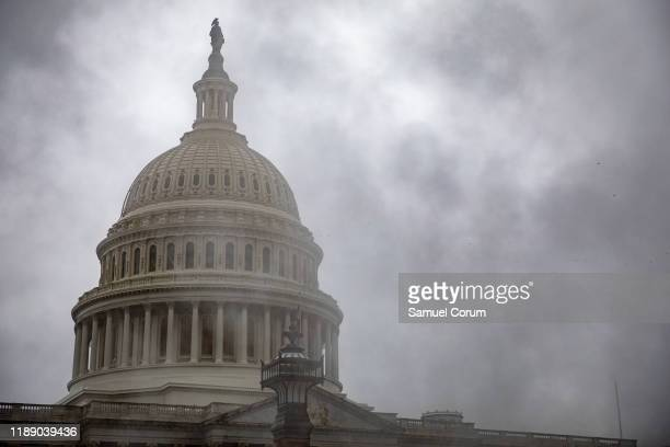 Steam from a vent obscures the US Capitol on the east front plaza on December 16 2019 in Washington DC Washington is preparing for the House of...