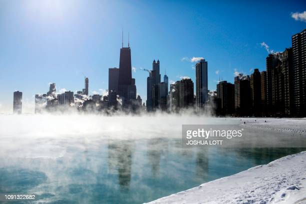 TOPSHOT Steam hovers above Lake Michigan as temperatures dropped to 20 degrees F on January 30 2019 in Chicago Illinois Frostbite warnings were...