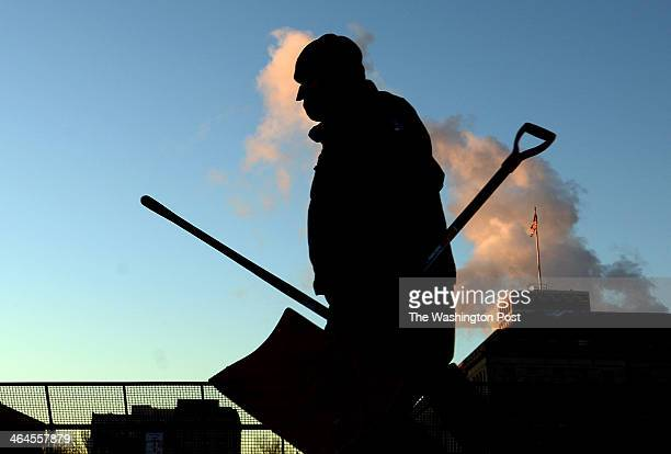Steam is seen coming out from the buildings along Independence Avenue where George Stinny of the National Park Service cleans up the sidewalks at the...