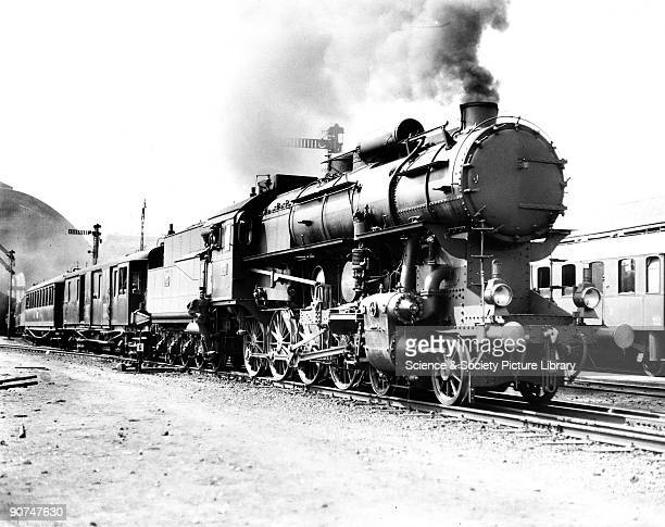 Steam locomotive, 1929. Hungarian Railways 424 Class 4-8-0 steam locomotive No 424.010 leaving Budapest East Station with the Simplon Orient Express...
