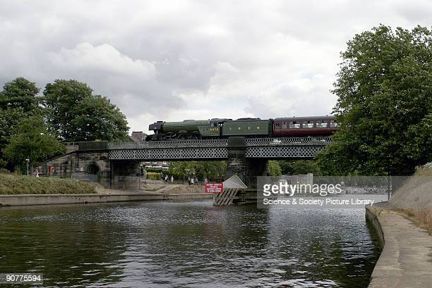 LNER steam locomotive 462 No 4472 Flying Scotsman crossing Scarborough bridge that spans the River Ouse at York on route to Scarborough The Flying...
