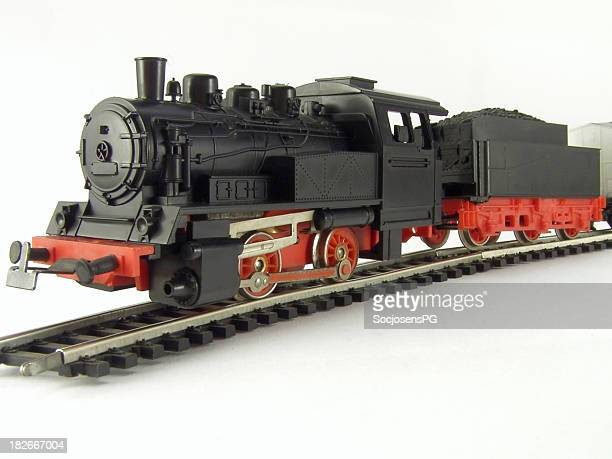 Steam locomotive and railroad tracks, children's toy, close-up