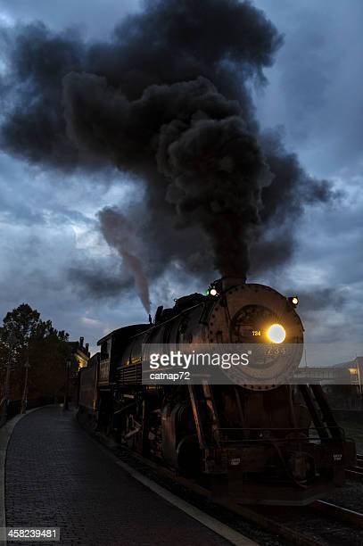 Steam Locomotive at Dawn Making Black Smoke; Train Station
