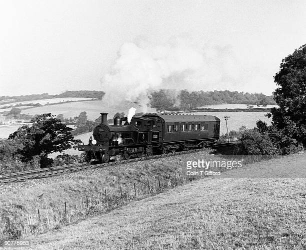 Steam locomotive class 0415 4-4-2T No 30582 with passenger train. Photograph by Colin T Gifford.