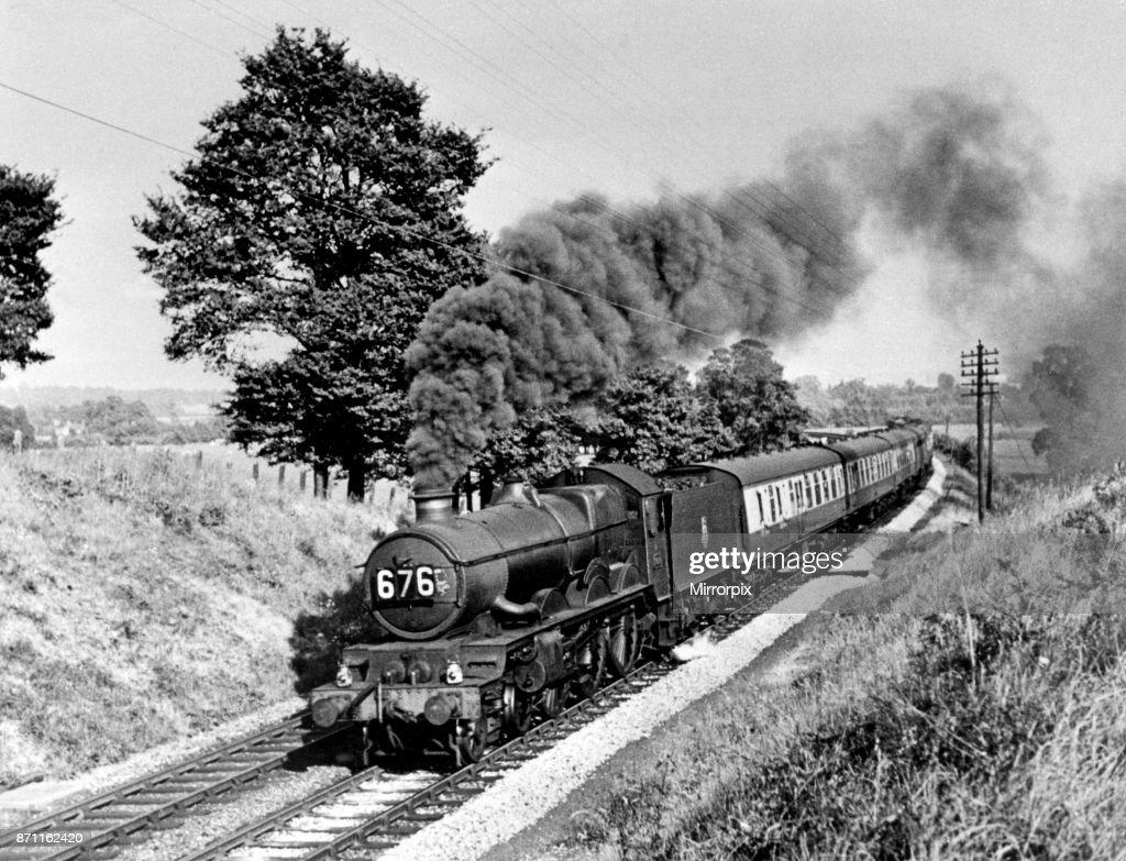 A steam locomotive engine making its way through the