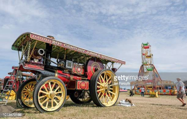Steam locomotive is parked near a steam powered ferris wheel during the final day of the Whitby Traction Engine Rally on August 5, 2018 in Whitby,...