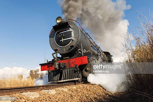 Steam locomotive puffing at full speed on railroad track, Magaliesburg, Gauteng Province, South Africa