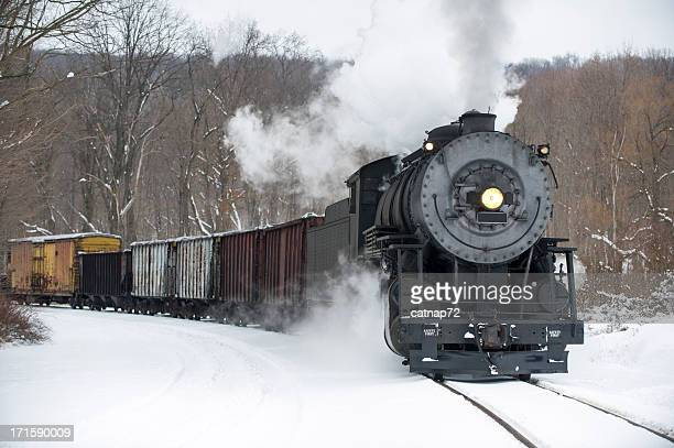 Steam Locomotive Pulling Train in Winter Snow, Rounding Curve