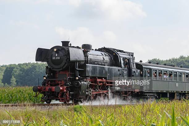 Steam locomotive with passenger railway cars