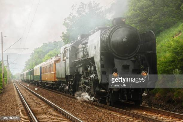 Steam locomotive with passenger railway cars