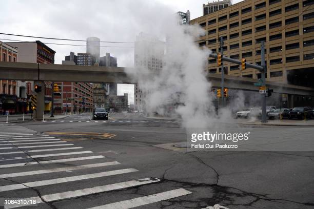 steam on the street and zebra crossing at detroit city, michigan, usa - detroit stock pictures, royalty-free photos & images