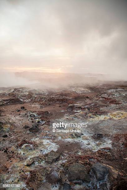 Steam over rock formations at geothermal area in Reykjanes peninsula