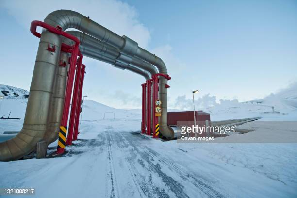 steam pipes at a geothermal power-plant in north iceland - arctic stock pictures, royalty-free photos & images