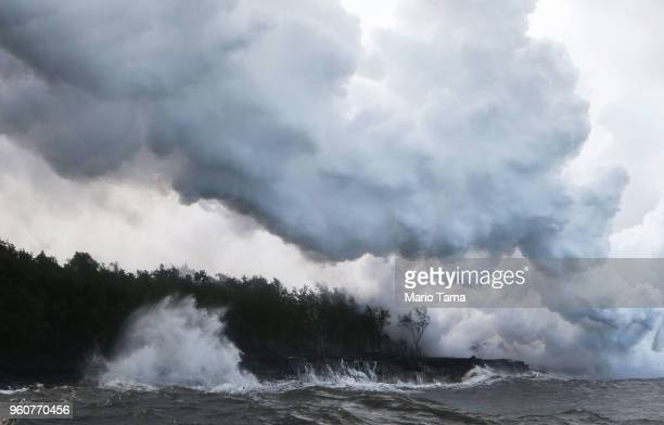 A steam plume rises from lava entering the Pacific Ocean after flowing to the water from a Kilauea volcano fissure on Hawaii's Big Island on May 20...