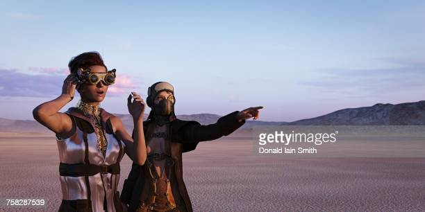 steam punks exploring in desert - steampunk stock photos and pictures