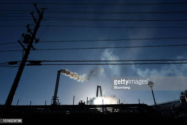 Steam rise from a stack at a plant in Nagoya Japan on Tuesday July 31 2018 Japan is scheduled to release trade balance figures for July on Aug 16...