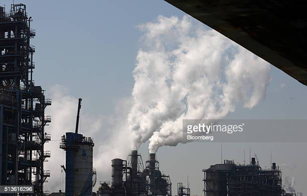 Steam rise from stacks at a plant in the Keihin Industrial Zone in Kawasaki Kanagawa Prefecture Japan on Thursday March 3 2016 The Japanese Cabinet...