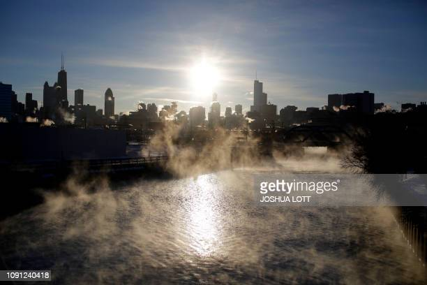 Steam rises above the North Branch Chicago River as temperatures dropped to 22 degrees Fahrenheit on January 30 2019 in Chicago Illinois A...