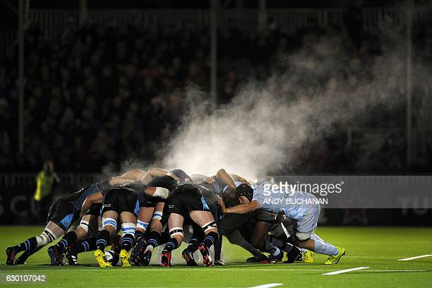 TOPSHOT Steam rises above the packs during a scrum during the European Champions Cup pool 1 rugby union match between Glasgow Warriors and Racing 92...