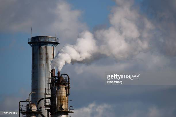 Steam rises from a stack in the Keihin industrial area of Kawasaki Kanagawa Prefecture Japan on Tuesday Dec 12 2017 The Bank of Japan will release...