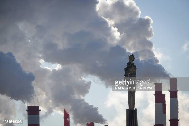 Steam rises from chimneys of a heating power plant behind a monument of Soviet cosmonaut Yuri Gagarin, the first man in space, in Moscow on March 11,...