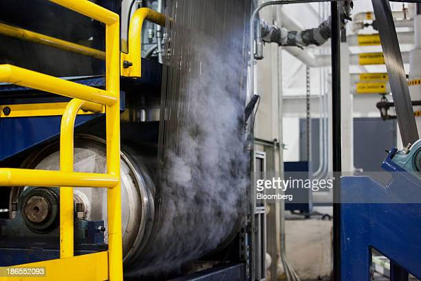 Steam rises from freshly made carbon fiber at the SGL Automotive Carbon Fibers manufacturing plant in Moses Lake Washington US on October 9 2013 The...