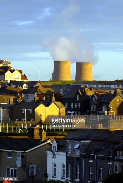 Steam rises from the cooling towers at Sellafield nuclear plant behind the village of Seascale in North England 26 September 2002 The 38 square km...