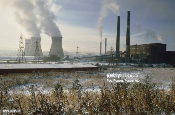 Steam rises from the cooling towers of the Stella coal fired power stations on both banks of the River Tyne in the North East of England in February...