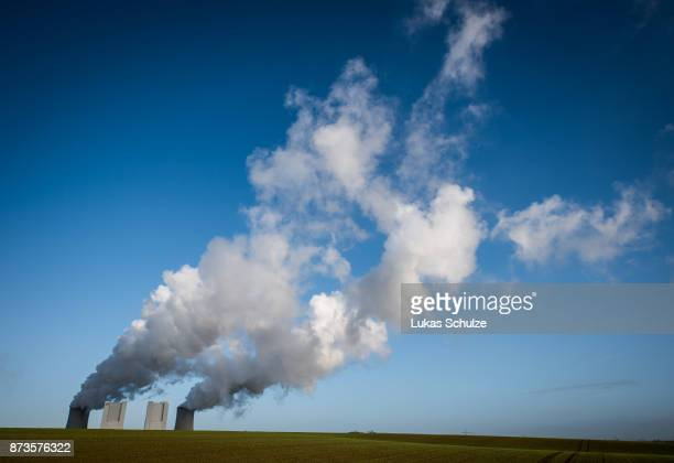 Steam rises from the Neurath coalfired power plant operated by German utility RWE which stands near openpit coal mines that feed it with coal on...