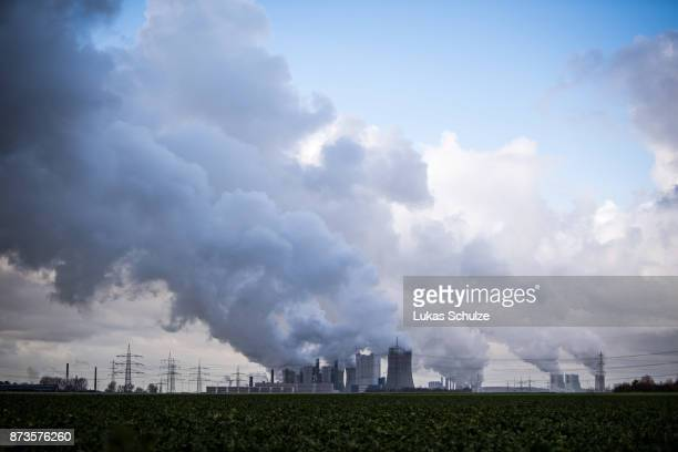 Steam rises from the Niederaussem coalfired power plant operated by German utility RWE which stands near openpit coal mines that feed it with coal on...