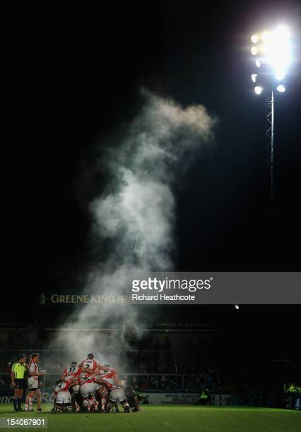 Steam rises from the pack as they wait to start a scrum during the Amiln Challenge Cup match between London Wasps and Newport Gwent Dragons at Adams...