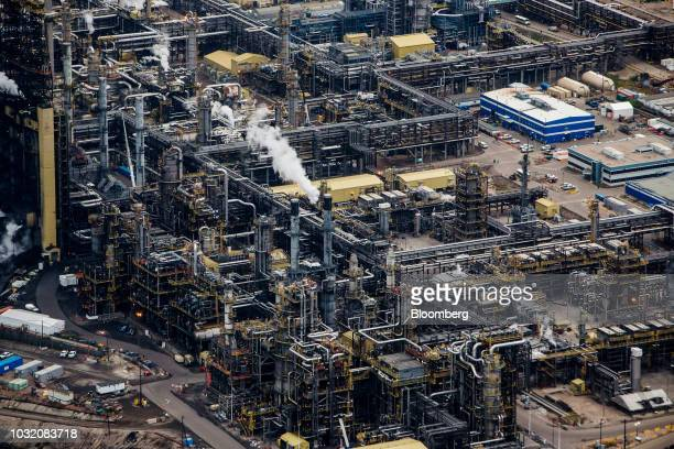 Steam rises from the Suncor Energy Inc Millennium upgrader plant in this aerial photograph taken above the Athabasca oil sands near Fort McMurray...