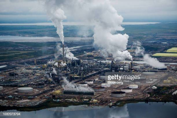Steam rises from the Syncrude Canada Ltd upgrader plant in this aerial photograph taken above the Athabasca oil sands near Fort McMurray Alberta...