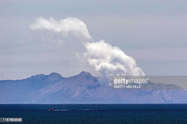 Steam rises from the White Island volcano following the December 9 volcanic eruption, in Whakatane on December 11, 2019. - The smouldering New...